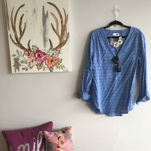 Classic blue tunic with striped detail